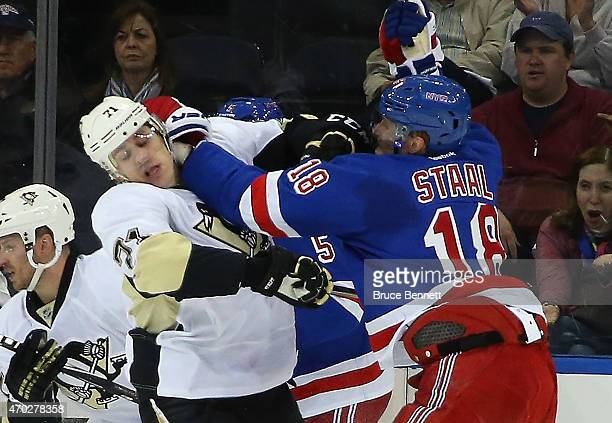 Marc Staal of the New York Rangers checks Evgeni Malkin of the Pittsburgh Penguins during the second period in Game One of the Eastern Conference...