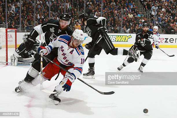 Marc Staal of the New York Rangers is pressures by Jake Muzzin of the Los Angeles Kings during the first period of Game Five of the 2014 Stanley Cup...