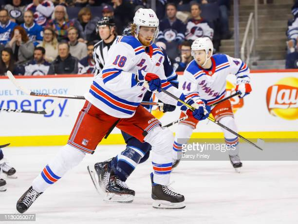 Marc Staal of the New York Rangers keeps an eye on the play during third period action against the Winnipeg Jets at the Bell MTS Place on February 12...