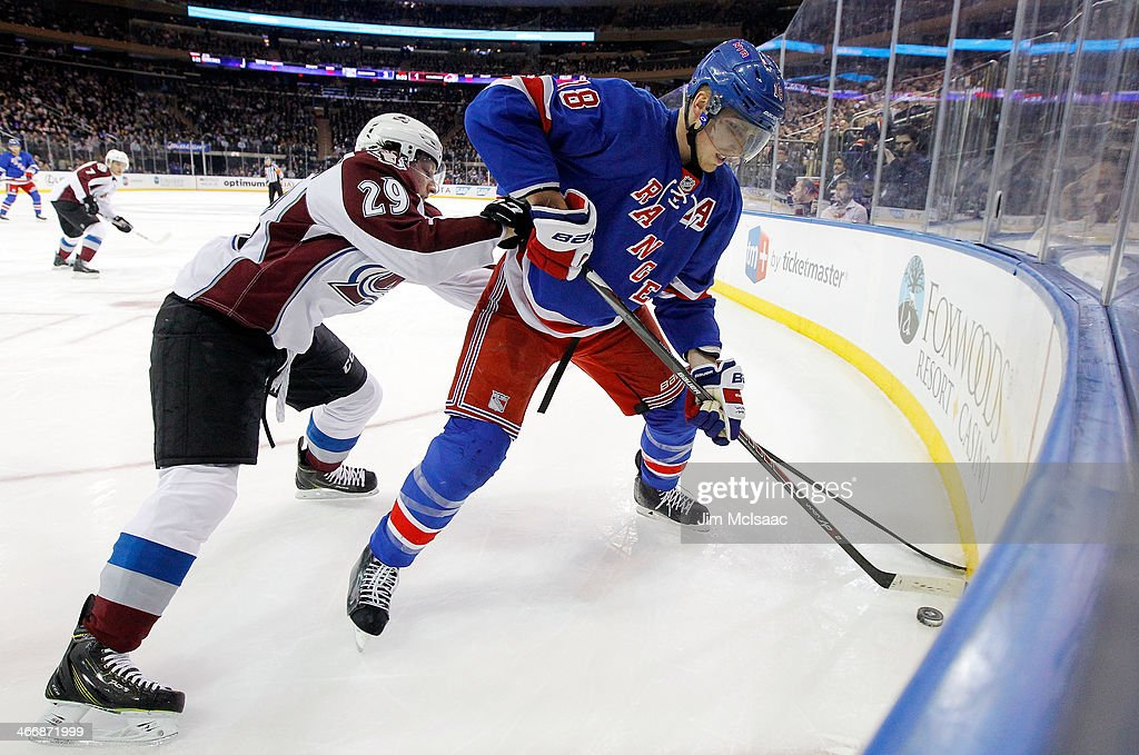 Marc Staal #18 of the New York Rangers keeps the puck from Nathan MacKinnon #29 of the Colorado Avalanche during a game at Madison Square Garden on February 4, 2014 in New York City.