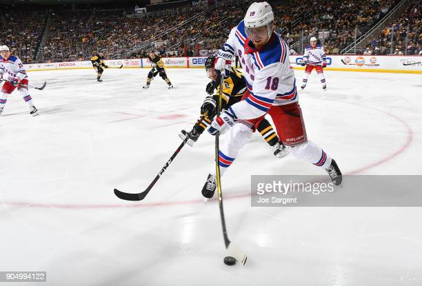 Marc Staal of the New York Rangers moves the puck in front of Patric Hornqvist of the Pittsburgh Penguins at PPG Paints Arena on January 14 2018 in...