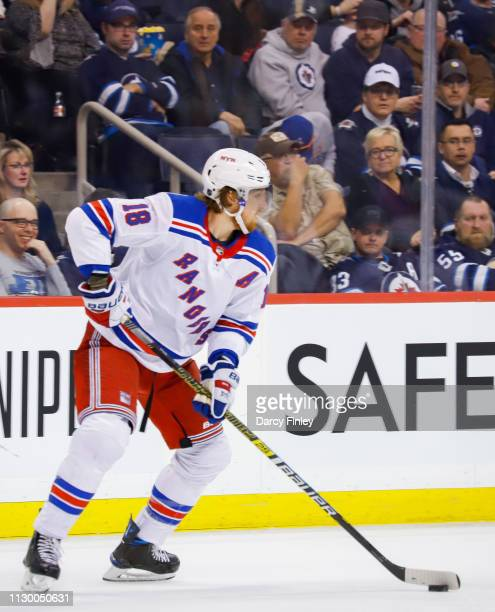 Marc Staal of the New York Rangers plays the puck up the ice during second period action against the Winnipeg Jets at the Bell MTS Place on February...