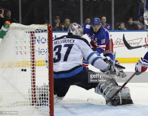 Marc Staal of the New York Rangers scores against Connor Hellebuyck of the Winnipeg Jets at 1211 of the second period at Madison Square Garden on...