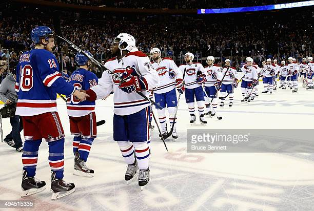 Marc Staal of the New York Rangers shakes hands PK Subban of the Montreal Canadiens after winning Game Six of the Eastern Conference Final in the...