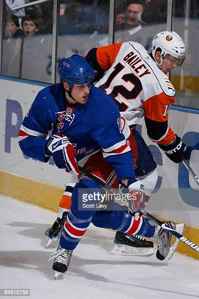 Marc Staal of the New York Rangers skates against Josh Bailey of the New York Islanders on February 18 2009 at Madison Square Garden in New York City