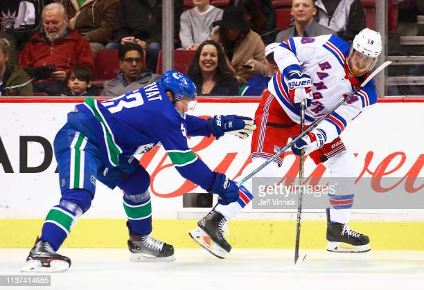 Marc Staal of the New York Rangers skates is checked by Bo Horvat of the Vancouver Canucks during their NHL game at Rogers Arena March 13 2019 in...