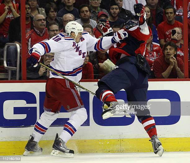 Marc Staal of the New York Rangers stops Alex Ovechkin of the Washington Capitals in Game One of the Eastern Conference Quarterfinals during the 2011...