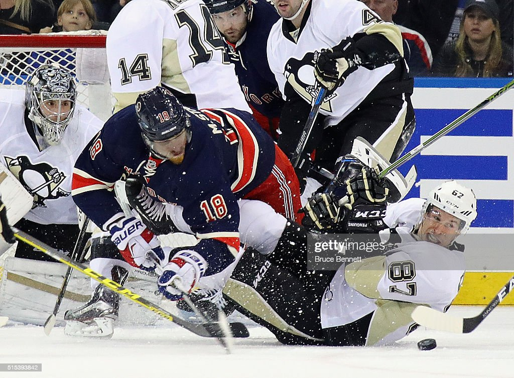 Marc Staal #18 of the New York Rangers trips over Sidney Crosby #87 of the Pittsburgh Penguins during the first period at Madison Square Garden on March 13, 2016 in New York City.