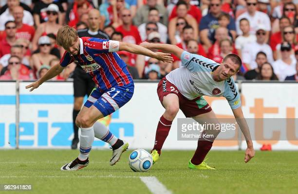 Marc Stein of Cottbus battles for the ball with Tim Wulff of Flensburg during the Third League Playoff Leg 2 match between FC Energie Cottbus and SC...