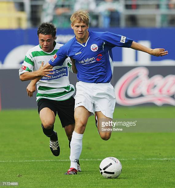 Marc Stein of Rostock goes past Stephan Schroeck of Furth during the Second Bundesliga match between Spvgg Greuther Furth and Hansa Rostock at the...