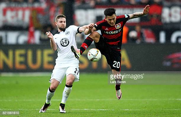 Marc Stendera of Frankfurt challenges Charles Aranguiz of Leverkusen during the Bundesliga match between Bayer Leverkusen and Eintracht Frankfurt at...