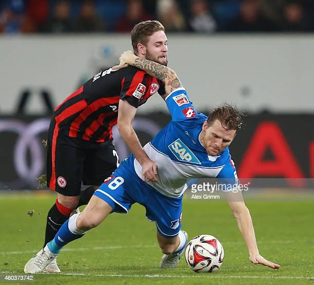 Marc Stendera of Frankfurt challenges Eugen Polanski of Hoffenheim during the Bundesliga match between 1899 Hoffenheim and Eintracht Frankfurt at...
