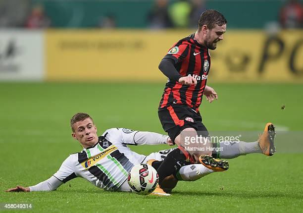 Marc Stendera of Frankfurt is challenged by Thorgan Hazard of Gladbach during the DFB cup second round match between Eintracht Frankfurt and Borussia...