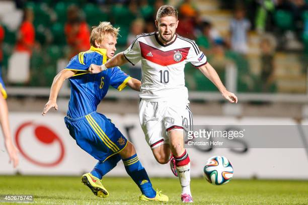 Marc Stendera of Germany challenges Viacheslav Tankovskyi of Ukraine during the UEFA Under19 European Championship match between U19 Germany and U19...