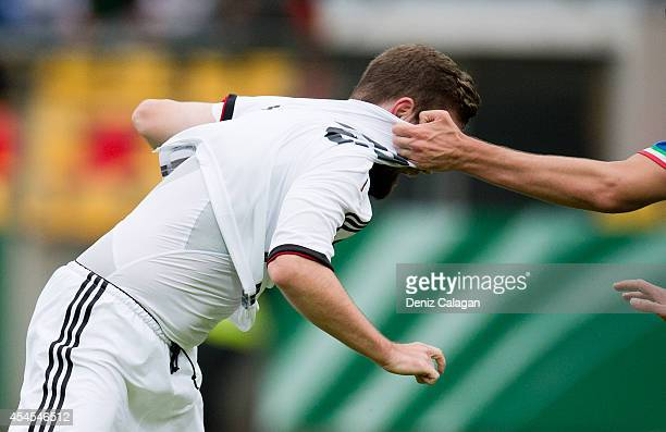 Marc Stendera of Germany gets pulled on his jersey during the international friendly match between U20 Germany and U20 Italy on September 3 2014 in...