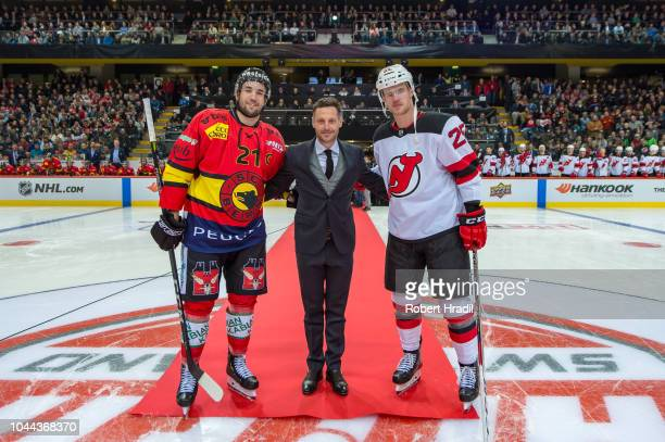 Marc Streit, former Swiss professional ice hockey player poses with Simon Moser of SC Bern and Mirco Mueller of New Jersey Devils during the NHL...