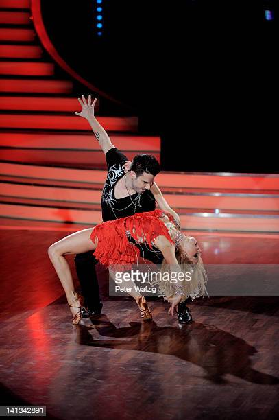 Marc Terenzi and Sarah Latton perform during the 'Let's Dance' TV Show on March 14 2012 in Cologne Germany