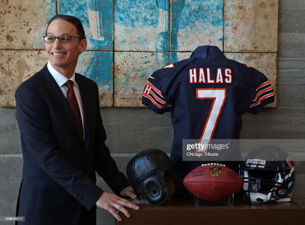 Marc Trestman poses for photographs after being introduced as head coach of the Chicago Bears at Halas Hall in Lake Forest, Illinois, on Thursday, January 17, 2013.