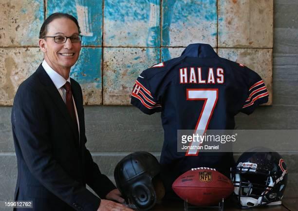Marc Trestman, the new head coach of the Chicago Bears, poses with a George Halas jersey following an introductory press conference at Halas Hall on...