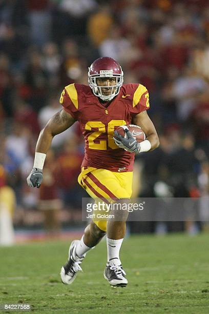 Marc Tyler of the USC Trojans carries the ball against the UCLA Bruins on December 6, 2008 at the Rose Bowl in Pasadena, California. USC won 28-7.