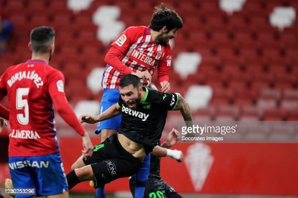 Marc Valiente of Real Sporting de Gijon causes penalty to Borja Baston of Leganes during the La Liga SmartBank match between Sporting Gijon v Leganes...