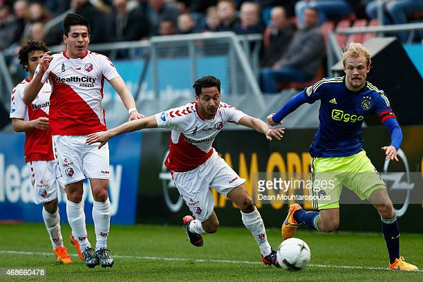 Marc Van der Maarel Yassine Ayoub and Rubio Rubin of Utrecht battle for the ball with Nicolai Boilesen of Ajax during the Dutch Eredivisie match...