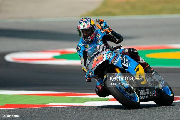 Marc VDS' Australian rider Jack Miller gestures as he takes a chicane during the first MotoGP free practice session of the Moto Grand Prix de...