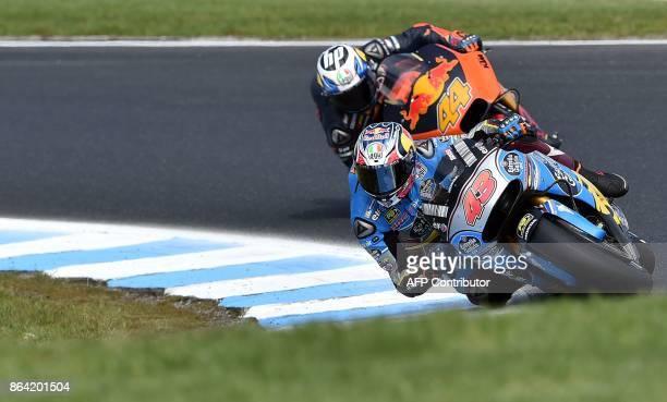 Marc VDS Honda rider Jack Miller of Australia leads KTM rider Pol Espargaro of Spain during the qualifying session of the Australian MotoGP Grand...