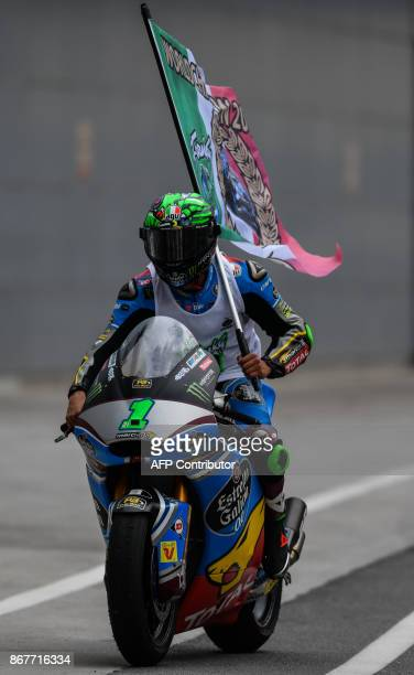Marc VDS rider Franco Morbidelli of Italy celebrates clinching the world championship after finishing third in the Moto2-class at the Sepang...
