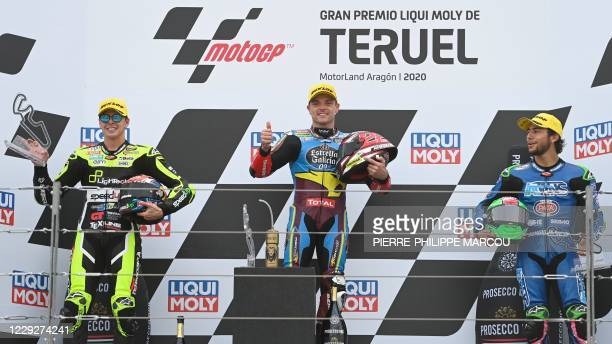 Marc VDS's British rider and winner Sam Lowes poses on the podium with MB Conveyors Speed Up's second-placed Italian rider Fabio Di Giannantonio and...