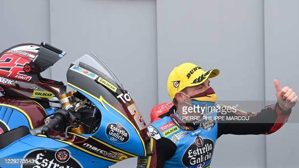 Marc VDS's British rider Sam Lowes celebrates after winning the Moto2 race of the Grand Prix of Teruel at the Motorland circuit in Alcaniz on October...