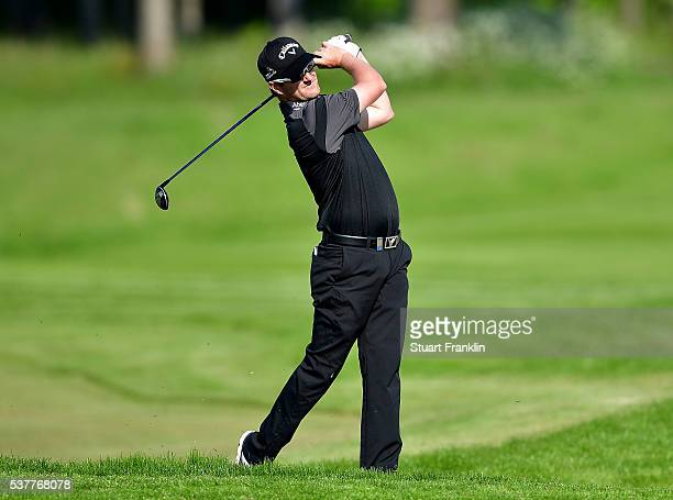 Marc Warren of England hits a shot on the 12th hole during the second round on day two of the Nordea Masters at Bro Hof Slott Golf Club on June 3,...