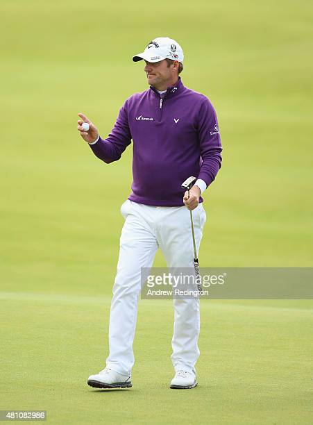 Marc Warren of Scotland acknowledges the crowd on the 18th green during the second round of the 144th Open Championship at The Old Course on July 17...