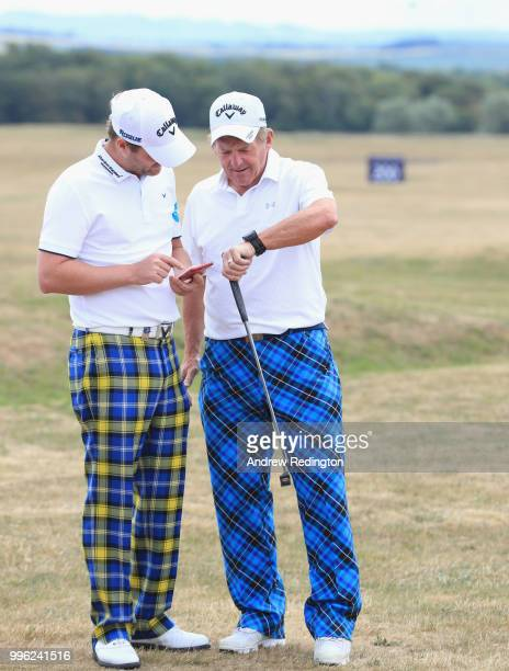 Marc Warren of Scotland and Kenny Dalglish Scottish football legend are pictured together during the Pro Am event prior to the start of the Aberdeen...