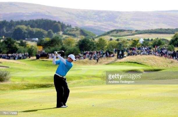 Marc Warren of Scotland hits his second shot on the 16th hole during the final round of the Johnnie Walker Championship on the PGA Centenary Course...
