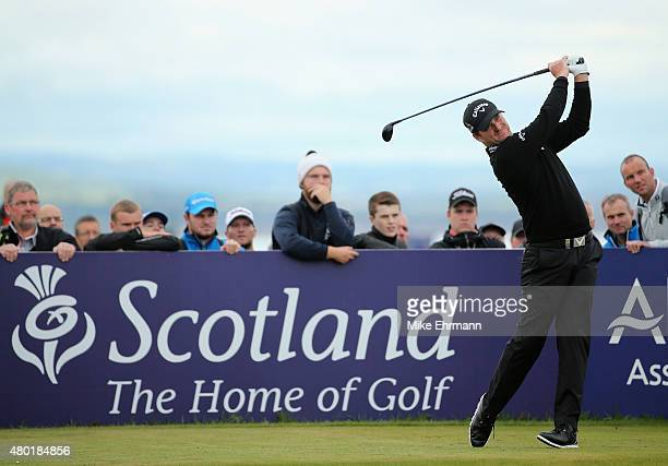 Marc Warren of Scotland hits his tee shot on the seventh hole during the second round of the Aberdeen Asset Management Scottish Open at Gullane Golf...