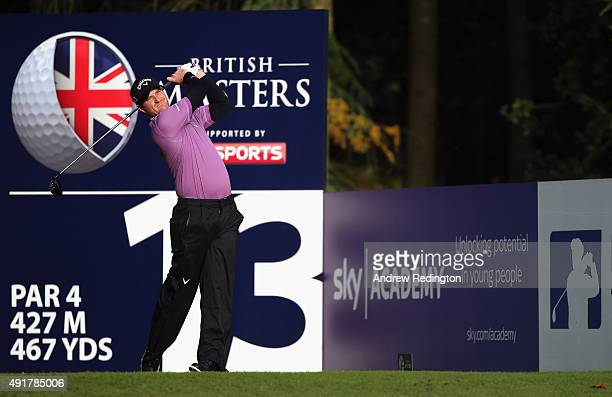 Marc Warren of Scotland hits his teeshot on the 13th hole during the first round of the British Masters supported by Sky Sports at Woburn Golf Club...