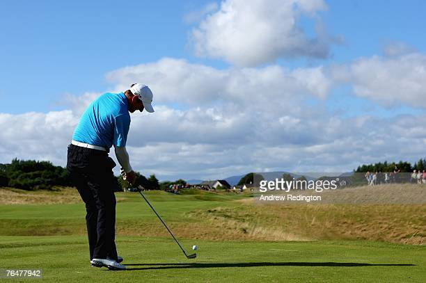 Marc Warren of Scotland hits his tee-shot on the 14th hole during the final round of the Johnnie Walker Championship on the PGA Centenary Course at...