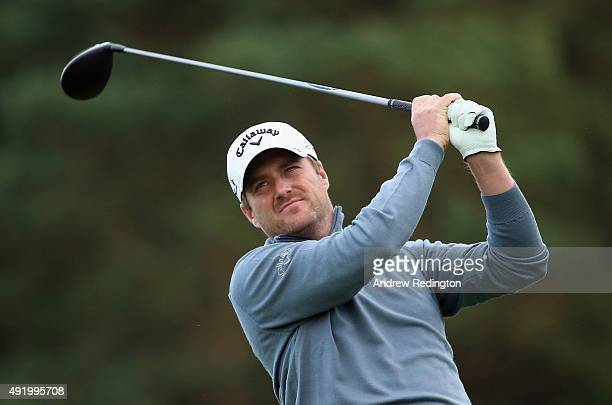 Marc Warren of Scotland hits his teeshot on the 15th hole during the second round of the British Masters supported by Sky Sports at Woburn Golf Club...