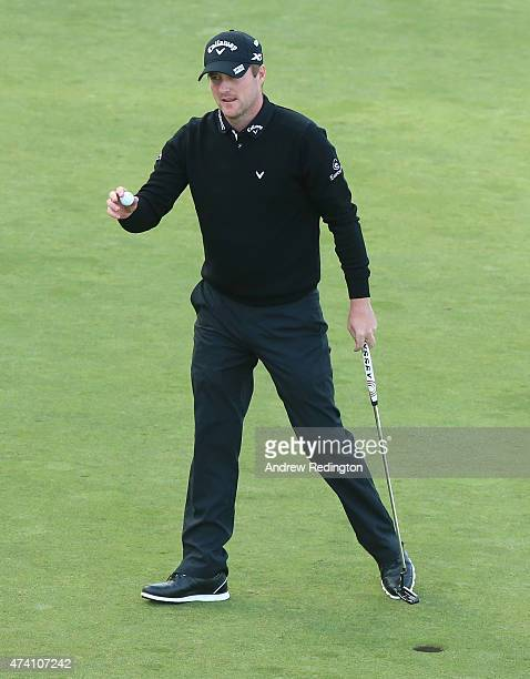 Marc Warren of Scotland holes out on the 18th green during the ProAm ahead of the BMW PGA Championship at Wentworth on May 20 2015 in Virginia Water...