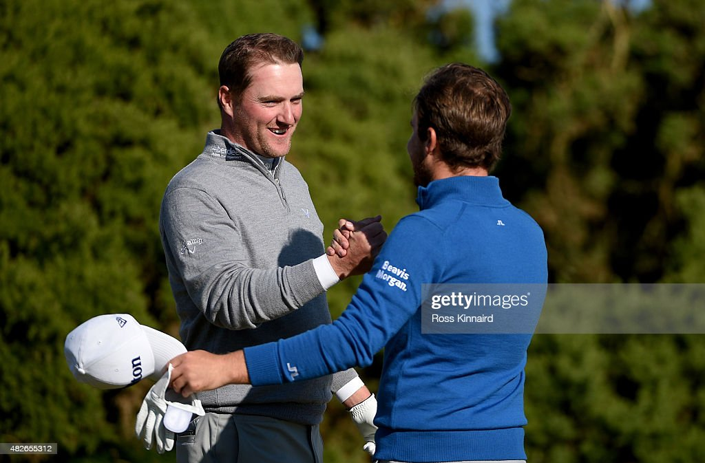 Marc Warren of Scotland is congratulated by Tyrrell Hatton of England after winning on the first extra hole during their Quater Final of the Saltire Energy Paul Lawrie Matchplay at Murcar Links Golf Course on August 1, 2015 in Aberdeen, Scotland.