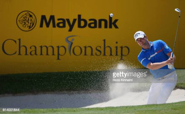 Marc Warren of Scotland plays a bunker shot on the 18th hole during day four of the Maybank Championship Malaysia at Saujana Golf and Country Club on...