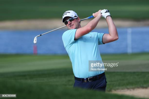 Marc Warren of Scotland plays a shot on the 14th hole during round one of the Abu Dhabi HSBC Golf Championship at Abu Dhabi Golf Club on January 18...