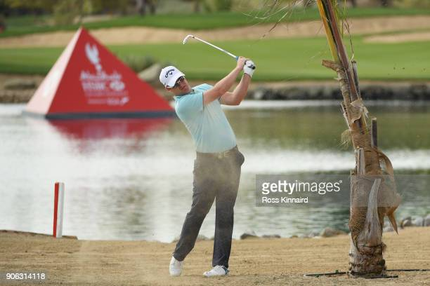 Marc Warren of Scotland plays his second shot in to the ninth hole during round one of the Abu Dhabi HSBC Golf Championship at Abu Dhabi Golf Club on...