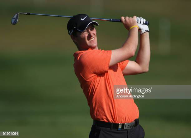 Marc Warren of Scotland plays his second shot on the ninth hole during the first round of the Portugal Masters at the Oceanico Victoria Golf Course...