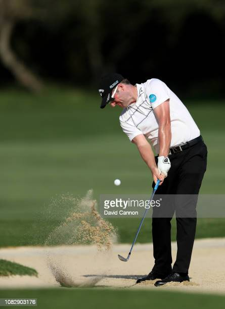 Marc Warren of Scotland plays his second shot on the par 4 17th hole during the third round of the Alfred Dunhill Championships at Leopard Creek...