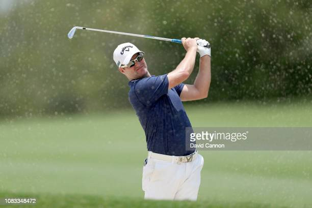 Marc Warren of Scotland plays his second shot on the par 5 second hole during the final round of the Alfred Dunhill Championships at Leopard Creek...