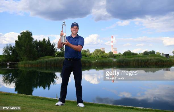 Marc Warren of Scotland poses with the trophy after winning the Austrian Open at Diamond Country Club on July 12, 2020 in Atzenbrugg, Austria.