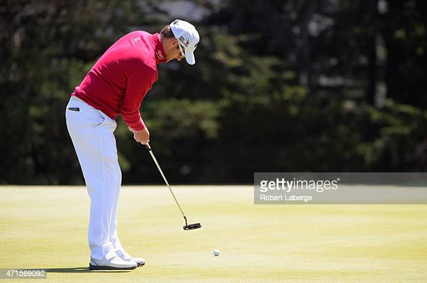 Marc Warren of Scotland putts on the fourth hole green during round one of the World Golf Championship Cadillac Match Play at TPC Harding Park on...