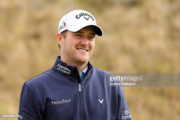 Marc Warren of Scotland smiles on the 13th tee during the first round of the AAM Scottish Open at Castle Stuart Golf Links on July 7 2016 in...